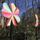 Detail of two of the 4' x 4' x 10' aluminum pinwheels in a kaleidoscope of colors that flank the two lane road of the Plaza Shamrock Neighborhood bridge in Charlotte, NC.