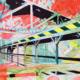 16″ x 20″ acrylic on canvas study of bridge from close, low perspective. Energetic, abstract background in various bright colors.