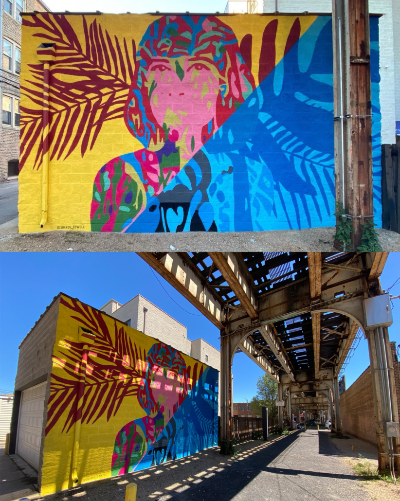 """15"""" h x 24' w mural on exterior concrete wall of woman painted in vibrant colors with shoulder-length hair facing forward, looking outward. Mural bisected diagonally: yellow background with maroon palm fronds on left side, right side blocked in all blues. In shadows of Ashland Ave L Train bridge, Lakeview Chicago."""