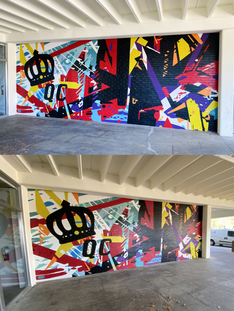 Energetic mural of geometric shapes & abstracted trusses & beams in bold colors on brick wall. Charlotte NC's crown logo and QC painted prominently in black on left side of mural. Located outside Bart's Bottle Shop, Eastway Shopping Center.