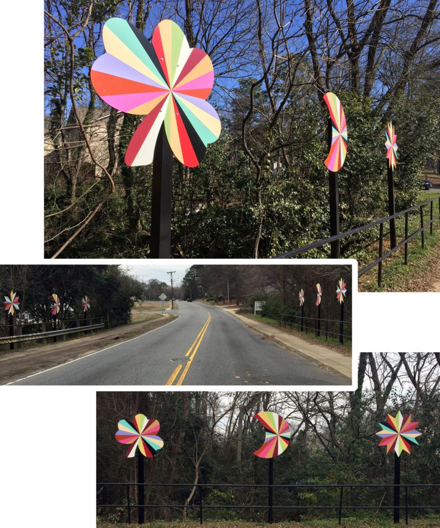 Six 4' x 4' x 10' aluminum pinwheels in a kaleidoscope of colors flank the two lane road of the Plaza Shamrock Neighborhood bridge in Charlotte, NC.